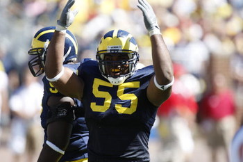 ANN ARBOR, MI - SEPTEMBER 6:  Defensive end Brandon Graham #55 of the Michigan Wolverines raises his arms during the game against the Miami of Ohio Red Hawks on September 6, 2008 at Michigan Stadium in Ann Arbor, Michigan.  The Wolverines defeated the Red