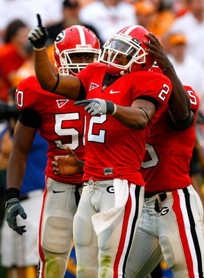 ATHENS, GA - OCTOBER 11:   Darryl Gamble #50 and Rennie Curran #35 celebrate with Asher Allen #2 of the Georgia Bulldogs after Allen's defensive stop against the Tennessee Volunteers during the game at Sanford Stadium on October 11, 2008 in Athens, Georgi