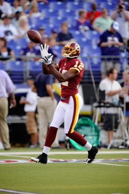 BALTIMORE, MD - AUGUST 13:  Malcolm  Kelly #12 of the Washington Redskins makes a catch during warm ups of a NFL preseason football game against the Baltimore Ravens on August 13, 2009 at M & T Bank Stadium in Baltimore, Maryland.   (Photo by Mitchell Lay