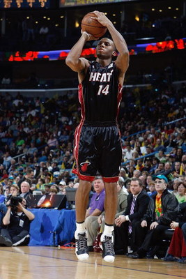 NEW ORLEANS - JANUARY 11:  Daequan Cook #14 of the Miami Heat takes a jump shot against the New Orleans Hornets on January 11, 2008 at the New Orleans Arena in New Orleans, Louisiana. The Hornets won 114-88. NOTE TO USER: User expressly acknowledges and a