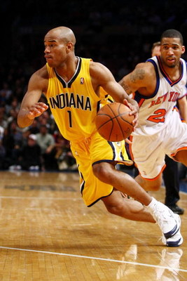 NEW YORK - FEBRUARY 23:  Jarrett Jack #1 of the Indiana Pacers drives to the basket past Wilson Chandler #21 of the New York Knicks during the game at Madison Square Garden February 23, 2009 in New York City.  The Knicks won 123-119.  NOTE TO USER: User e