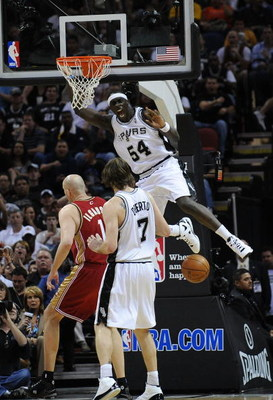 SAN ANTONIO - FEBRUARY 27:  Forward Pops Mensah-Bonsu #54 of the San Antonio Spurs reacts after getting a dunk against Zydrunas Ilgauskas #11 of the Cleveland Cavaliers on February 27, 2009 at AT&T Center in San Antonio, Texas.  NOTE TO USER: User express