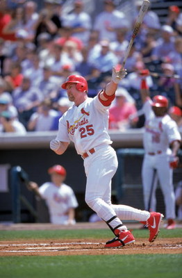 20 Mar 2000: First baseman Mark McGwire #25 of the St. Louis Cardinals at bat during the Spring Training Game against the Philadelphia Phillies at the Roger Dean Stadium in Jupiter, Florida. The Phillies defeated the Cardinals 8-7.