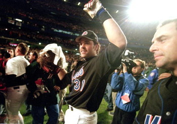 16 Oct 2000:   Catcher Mike Piazza #31 of the New York Mets celebrate with win as he walks off the field after the National Leage Division Series Game Five against the St. Louis Cardinals at Shea Stadium in Flushing, New York. The Mets defeated the Cardin