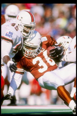 1 Jan 1991:  Running back Adrian Walker of the Texas Longhorns is tackled during the Cotton Bowl against the Miami Hurricanes at the Cotton Bowl in Dallas, Texas.  Miami won the game 46-3. Mandatory Credit: Joe Patronite  /Allsport