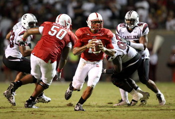 RALEIGH, NC - SEPTEMBER 3:  Quarterback Russell Wilson #16 of the North Carolina State Wolfpack drops back to pass with protection by Jeraill McCuller #50 against the South Carolina Gamecocks during the game at Carter-Finley Stadium on September 3, 2009 i