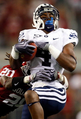 ARLINGTON, TX - SEPTEMBER 05:  Wide receiver O'Neill Chambers #4 of the Brigham Young Cougars makes a pass reception against Quinton Carter #20 of the Oklahoma Sooners at Cowboys Stadium on September 5, 2009 in Arlington, Texas.  (Photo by Ronald Martinez