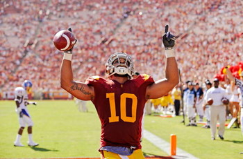 LOS ANGELES, CA - SEPTEMBER 05:  D.J. Shoemate #10 of the USC Trojans celebrates after scoring a touchdown against the San Jose State Spartans during the fourth quarter at Los Angeles Memorial Coliseum on September 5, 2009 in Los Angeles, California. USC