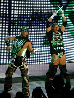 LAS VEGAS - AUGUST 24:  Wrestlers and tag team partners Shawn Michaels (L) and Triple H are introduced during the WWE Monday Night Raw show at the Thomas &amp; Mack Center August 24, 2009 in Las Vegas, Nevada.  (Photo by Ethan Miller/Getty Images)