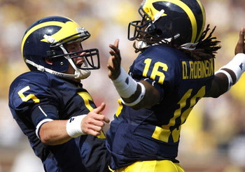 ANN ARBOR, MI - SEPTEMBER 05:  Tate Forcier #5 of the Michigan Wolverines celebrates with Denard Robinson #16 after Robinson ran for a long first quarter touchdown against the Western Michigan Broncos on September 5, 2009 at Michigan Stadium in Ann Arbor,