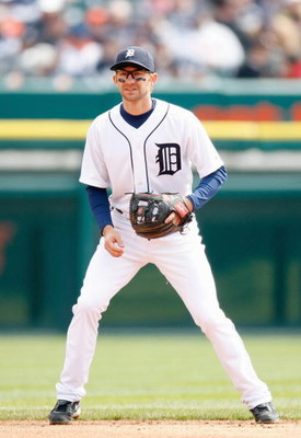 DETROIT - APRIL 10:  Adam Everett #4 of the Detroit Tigers gets ready infield against the Texas Rangers during Opening Day on April 10, 2009 at Comerica Park in Detroit, Michigan. Detroit won the game 15-2. (Photo by Gregory Shamus/Getty Images)