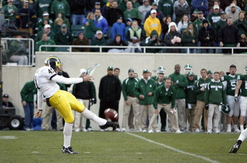 EAST LANSING, MI - NOVEMBER 3: Zoltan Mesko #41 of the Michigan Wolverines punts the ball during the game against the Michigan State Spartans at Spartan Stadium November 3, 2007 in East Lansing, Michigan.  Michigan defeated Michigan State 28-24. (Photo by