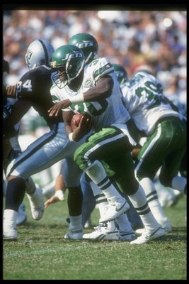 10 Oct 1993:  Running back Brad Baxter of the New York Jets moves the ball during a game against the Los Angeles Raiders at the Coliseum in Los Angeles, California.  The Raiders won the game, 24-20. Mandatory Credit: Stephen Dunn  /Allsport
