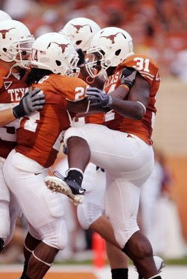 AUSTIN, TX - SEPTEMBER 05:  Running back Cody Johnson #31 of the Texas Longhorns celebrates his third touchdown against the Louisiana Monroe Warhawks in the second quarter on September 5, 2009 at Darrell K Royal-Texas Memorial Stadium in Austin, Texas.  (