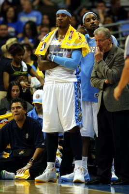 DENVER - MAY 29:  Carmelo Anthony #15 of the Denver Nuggets looks on from the bench in the fourth quarter of Game Six of the Western Conference Finals during the 2009 NBA Playoffs against the Los Angeles Lakers at Pepsi Center on May 29, 2009 in Denver, C