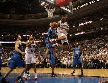 PHILADELPHIA - APRIL 30:  Andre Iguodala #9 of the Philadelphia 76ers lays the ball up against the Orlando Magic during Game Six of the Eastern Conference Quarterfinals at Wachovia Center on April 30, 2009 in Philadelphia, Pennsylvania. NOTE TO USER: User