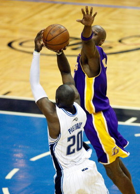 ORLANDO, FL - JUNE 11:  Mickael Pietrus #20 of the Orlando Magic attempts a game-winning shot over Lamar Odom #7 in the fourth quarter of Game Four of the 2009 NBA Finals on June 11, 2009 at Amway Arena in Orlando, Florida.  NOTE TO USER:  User expressly