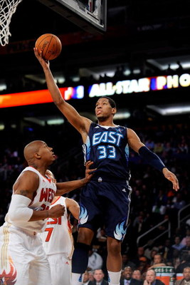 PHOENIX - FEBRUARY 15:  Danny Granger #33 of the Eastern Conference lays the ball up over David West #30 of the Western Conference during the 58th NBA All-Star Game, part of 2009 NBA All-Star Weekend at US Airways Center on February 15, 2009 in Phoenix, A