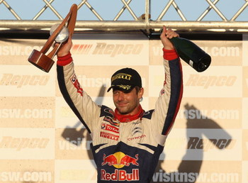 KINGSCLIFF, AUSTRALIA - SEPTEMBER 06:  Sebastien Loeb of France and the Citroen C4 Total team celebrates winning the Repco Rally of Australia on September 6, 2009 in Kingscliff, Australia.  (Photo by Quinn Rooney/Getty Images)