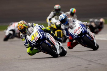 INDIANAPOLIS - AUGUST 30:  Valentino Rossi of Italy, rider of the #46 Fiat Yamaha Team leads his teammate Jorge Lorenzo of Spain, rider of the #99 during the MotoGP Red Bull Indianapolis Grand Prix at the Indianapolis Motor Speedway on August 30, 2009 in