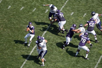 EVANSTON, IL - SEPTEMBER 8:  Quarterback C.J. Bacher #18 of the Northwestern Wildcats looks to pass during the game against the Nevada Wolf Pack on September 8, 2007 at Ryan Field at Northwestern University in Evanston, Illinois. (Photo by Jonathan Daniel