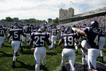 EVANSTON, IL - SEPTEMBER 08:  Members of the Northwestern Wildcats run onto the field before a game against the Nevada Wolf Pack on September 8, 2007 at Ryan Field at Northwestern University in Evanston, Illinois. Northwestern defeated Nevada 36-31. (Phot