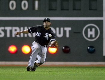 BOSTON - AUGUST 26:  Carlos Quentin #20 of the Chicago White Sox makes the catch for out on a hit by Casey Kotchman of the Boston Red Sox on August 26, 2009 at Fenway Park in Boston, Massachusetts.  (Photo by Elsa/Getty Images)