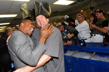 CHICAGO - SEPTEMBER 30:  General Manager Kenny Williams (L) and Jim Thome #25 of the Chicago White Sox are sprayed with champange by Toby Hall #44 in the locker room as they celebrate their 1-0 win against the Minnesota Twins during the American League Ce