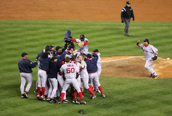 NEW YORK - OCTOBER 20:  The Boston Red Sox celebrate after defeating the New York Yankees 10-3 to win game seven of the American League Championship Series on October 20, 2004 at Yankee Stadium in the Bronx borough of New York City. (Photo by Ezra Shaw/Ge