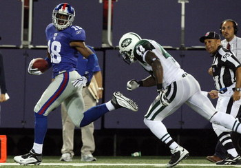 EAST RUTHERFORD, NJ - AUGUST 29:  Hakeem Nicks #18 of the New York Giants runs a reception past James Ihedigbo #44 of the New York Jets for a fourth quarter touchdown on August 29, 2009 at Giants Stadium in East Rutherford, New Jersey.  (Photo by Jim McIs