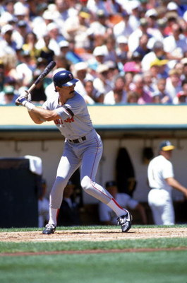 OAKLAND, CA - 1990:  Dwight Evans #24 of the Boston Red Sox bats against the Oakland Athletics during a game in the 1990 season at Oakland Alameda Coliseum in Oakland, California. (Photo by Otto Greule Jr/Getty Images)