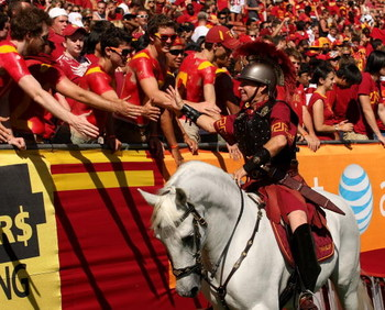 LOS ANGELES - SEPTEMBER 5:  Trojan mascot Traveller VII rider Hector Aguilar shakes hands with fans after a USC Trojans touchdown against the San Jose State Spartans on September 5, 2009 at the Los Angeles Coliseum in Los Angeles, California.   (Photo by