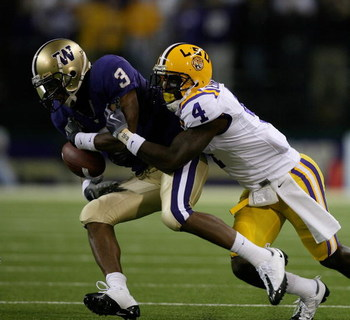 SEATTLE - SEPTEMBER 05:  Wide receiver James Johnson #3 of the Washington Huskies makes a catch against Jai Eugene #4 of the LSU Tigers on September 5, 2009 at Husky Stadium in Seattle, Washington. The Tigers defeated the Huskies 31-23. (Photo by Otto Gre