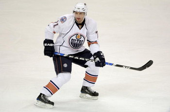 DENVER - JANUARY 16:  Lubomir Visnovsky #71 of the Edmonton Oilers skates against the Colorado Avalanche during NHL action at the Pepsi Center on January 16, 2009 in Denver, Coloado. The Oilers defeated the Avalanche 3-2.  (Photo by Doug Pensinger/Getty I