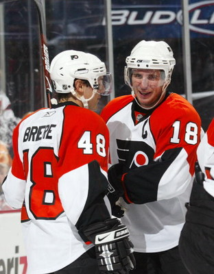 NEWARK, NJ - OCTOBER 04: Daniel Briere #48 (L0 and Mike Richards #18 (R) of the Philadelphia Flyers celebrate Briere's third period goal against the New Jersey Devils on October 4, 2008 at the Prudential Center in Newark, New Jersey. The Devils defetaed t