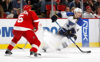 DETROIT - MARCH 28:  Eric Brewer #4 of the St.Louis Blues carries the puck as he is defended by Nicklas Lidstrom #5 of the Detroit Red Wings during their NHL game at Joe Louis Arena March 28, 2008 in Detroit, Michigan.(Photo By Dave Sandford/Getty Images)