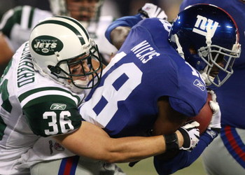 EAST RUTHERFORD, NJ - AUGUST 29:  Safety Jim Leonhard #36 of the New York Jets tackles wide receiver Hakeem Nicks #18 of the New York Giants during the preseason game at Giants Stadium on August 29, 2009 in East Rutherford, New Jersey.  (Photo by Jim McIs