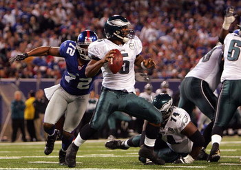 EAST RUTHERFORD, NJ - SEPTEMBER 30:  Donovan McNabb #5 of the Philadelphia Eagles gets sacked by Osi Umenyiora #72 of the New York Giants at Giants Stadium on September 30, 2007 in East Rutherford, New Jersey.  (Photo by Nick Laham/Getty Images)