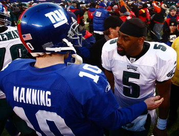 EAST RUTHERFORD, NJ - JANUARY 11:  Eli Manning #10 of the New York Giants greets Donovan McNabb #5 of the Philadelphia Eagles after the NFC Divisional Playoff Game on January 11, 2009 at Giants Stadium in East Rutherford, New Jersey.The Eagles won the gam