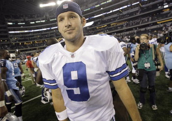 ARLINGTON, TX - AUGUST 21:  Quarterback Tony Romo #9 of the Dallas Cowboys walks off the field after the Cowboys beat the Tennessee Titans during a preseason game at Dallas Cowboys Stadium on August 21, 2009 in Arlington, Texas. (Photo by Tom Pennington/G