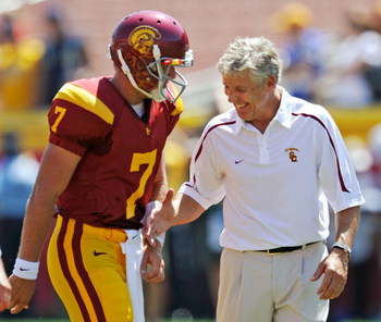 LOS ANGELES, CA - SEPTEMBER 05:  Matt Barkley #7 of USC Trojans is congratulated by head coach Pete Carroll during warm up before the opener against visiting San Jose State Spartans as he becomes the fourth-ranked Trojans' first-ever true freshman starter