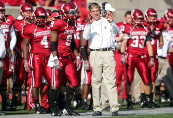 BLOOMINGTON, IN - NOVEMBER 3: Bill Lynch, the Head Coach of the Indiana Hoosiers, gives instructions to Tracy Porter #9 during the game against the Ball State Cardinals at Memorial Stadium November 3, 2007 in Bloomington, Indiana.  (Photo by Andy Lyons/Ge