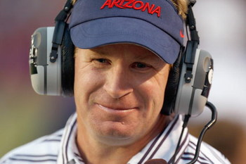TUSCON - OCTOBER 4:  Head coach Mike Stoops of the Arizona Wildcats looks on during the game against the Washington Huskies on October 4, 2008 at Arizona Stadium in Tucson, Arizona. (Photo by: Gregory Shamus/Getty Images)