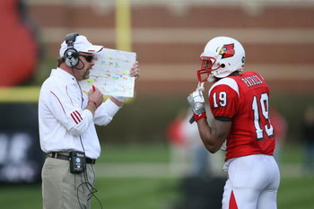LOUISVILLE, KY - OCTOBER 18:  Head Coach Steve Kragthorpe of the Louisville Cardinals discusses play with Johnny Patrick #19 during the game against the Middle Tennessee Blue Raiders at Papa John's Cardinal Stadium on October 18, 2008 in Louisville, Kentu