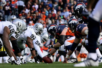DENVER - NOVEMBER 23:  The Denver Broncos offense lines up on the line of scrimmage against the Oakland Raiders defense during week 12 NFL action at Invesco Field at Mile High on November 23, 2008 in Denver, Colorado. The Raiders defeated the Broncos 31-1