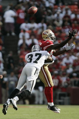 SAN FRANCISCO - AUGUST 22:  San Francisco 49ers wide receiver Josh Morgan #84 goes up for the ball as Oakland Raiders cornerback Chris Johnson #37 defends during the 1st quarter as the San Francisco 49ers host the Oakland Raiders at Candlestick Park Augus