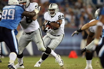 NASHVILLE, TN - AUGUST 15: Michael Bush #29 of the Oakland Raiders runs with the ball during the NFL pre-season game against the Tennessee Titans at LP Field August 15, 2008 in Nashville, Tennessee.  (Photo by Andy Lyons/Getty Images)
