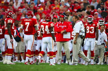 KANSAS CITY, MO - AUGUST 29: Quaterback Matt Cassel #7 of the Kansas City Chiefs walks with teammates Dwayne Bowe #82 and Bobby Engram #84 to the sidelines towards head coach Todd Haley (C)  after Cassell appeared to hurt his left leg against the Seattle