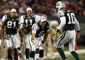 EAST RUTHERFORD, NJ - SEPTEMBER 03:  Quarterback Mark Sanchez #6 of the New York Jets congratulates teammate Erik Ainge #10 after a touchdown against the Philadelphia Eagles during the NFL preseason game at Giants Stadium on September 3, 2009 in East Ruth