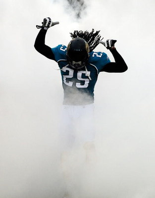 JACKSONVILLE, FL - SEPTEMBER 03:  Reggie Nelson #25 of the Jacksonville Jaguars makes an entrance to the stadium during the game against the Washington Redskins at Jacksonville Municipal Stadium on September 3, 2009 in Jacksonville, Florida.  (Photo by Sa